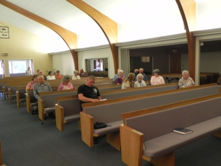 People began to fill the pews in anticipation of the seminar